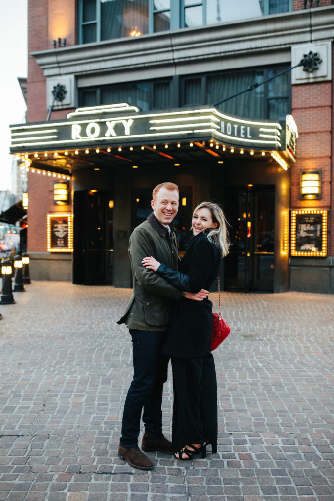 Caroline and Jon engagement photo outside The Roxy Hotel in New York, NY