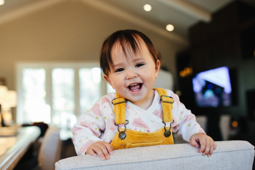 Smiling baby at home in the Bay Area, CA
