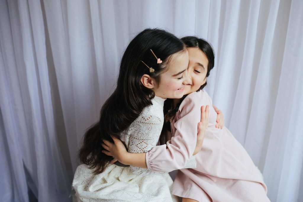 Sisters hugging on the Upper East Side, NYC