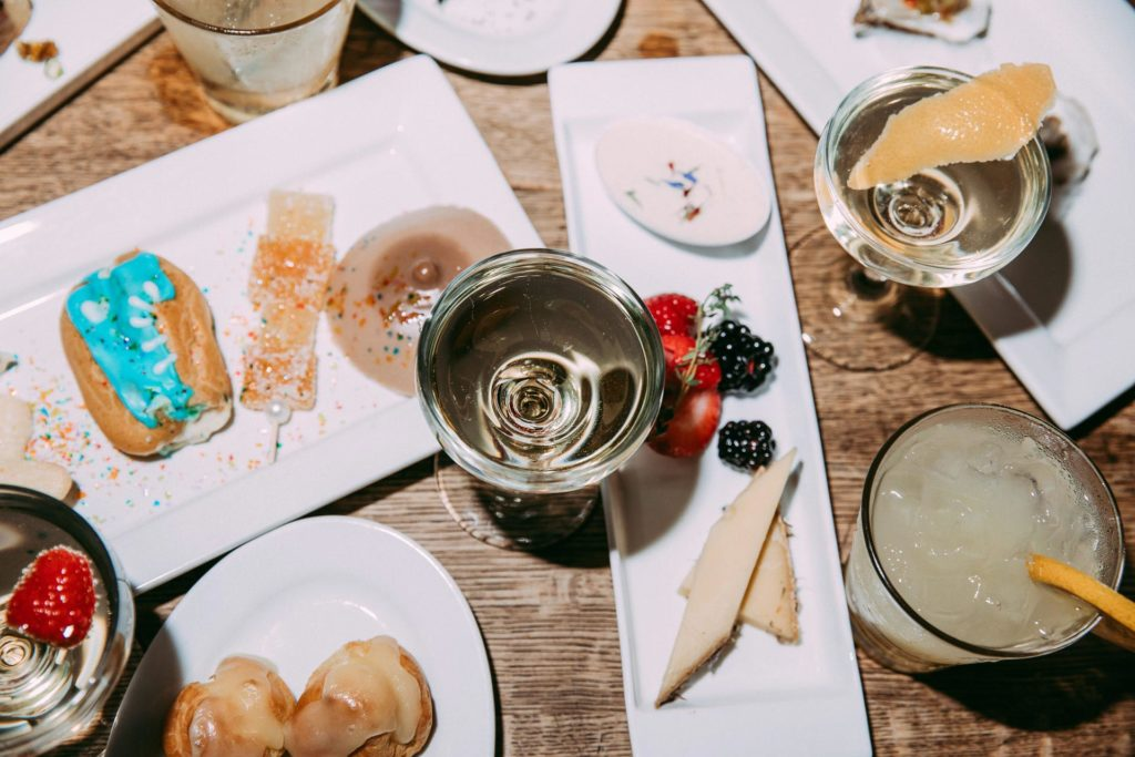 Champagne glass with cheese plate and pastries at Nitehawk theater in Brooklyn NY