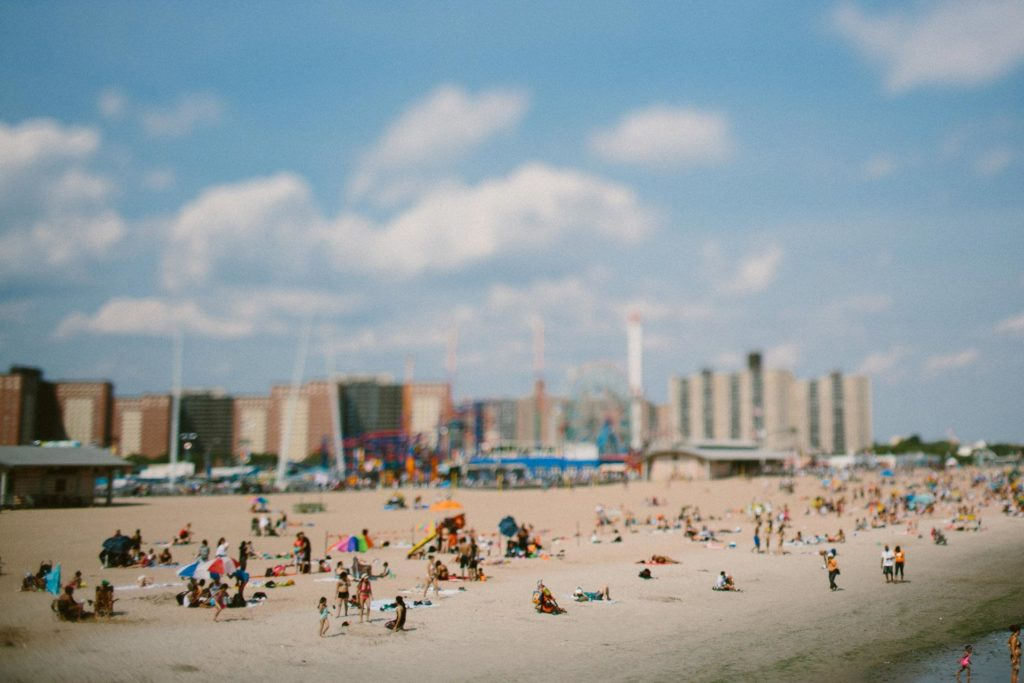 The beach at Coney Island with Luna Park and blue sky in Brooklyn NY