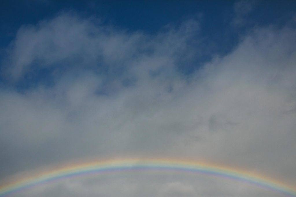 A blue sky with clouds and a rainbow in San Francisco CA