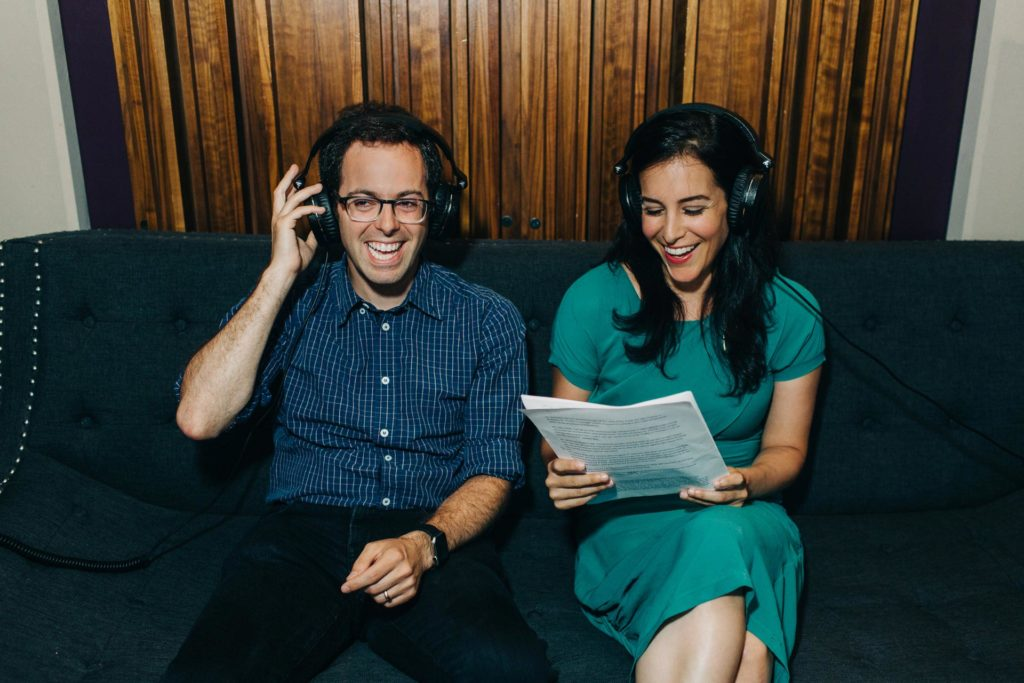 Portrait of comedian Elliott Kalan and writer Alexis Coe recording an episode of their podcast for Audible in New York, NY