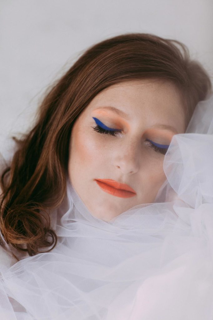 Portrait of Liz with eyes closed and experimental makeup in New York, NY