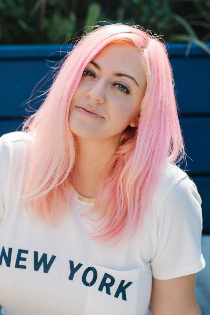 Portrait of Alex with pink hair on the roof of The Wing Flatiron in New York, NY