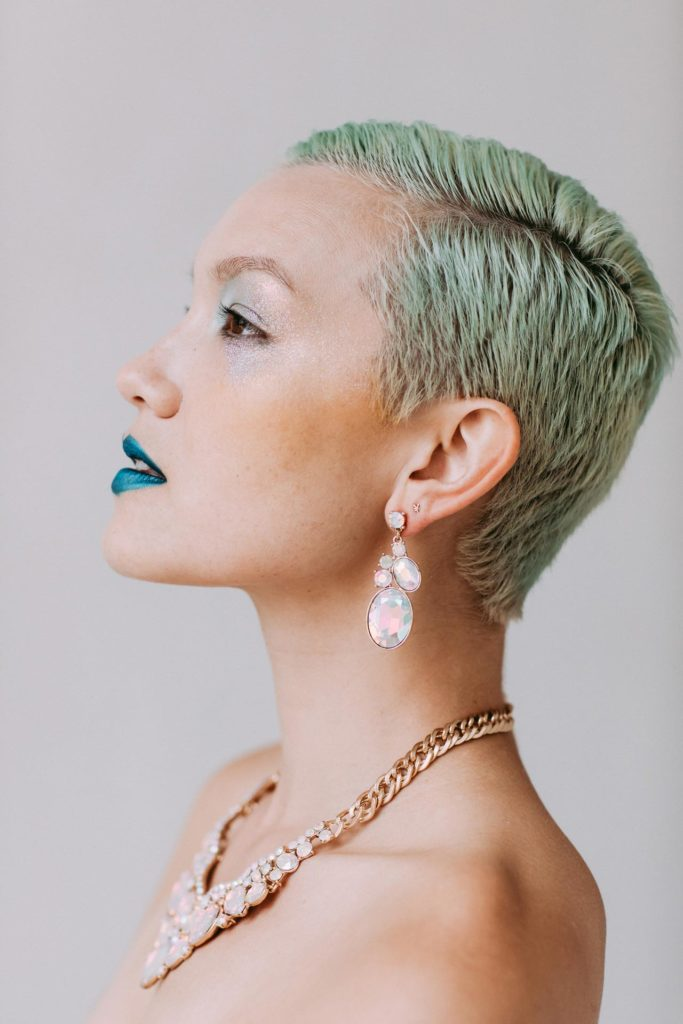 Portrait of Tiff with green hair, blue lipstick and jewels in New York, NY