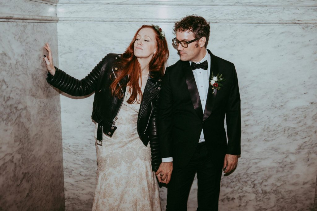 Helena Fitzgerald and Thomas Strickland at their wedding with motorcycle jacket at the Mutter Museum in Philadelphia, PA