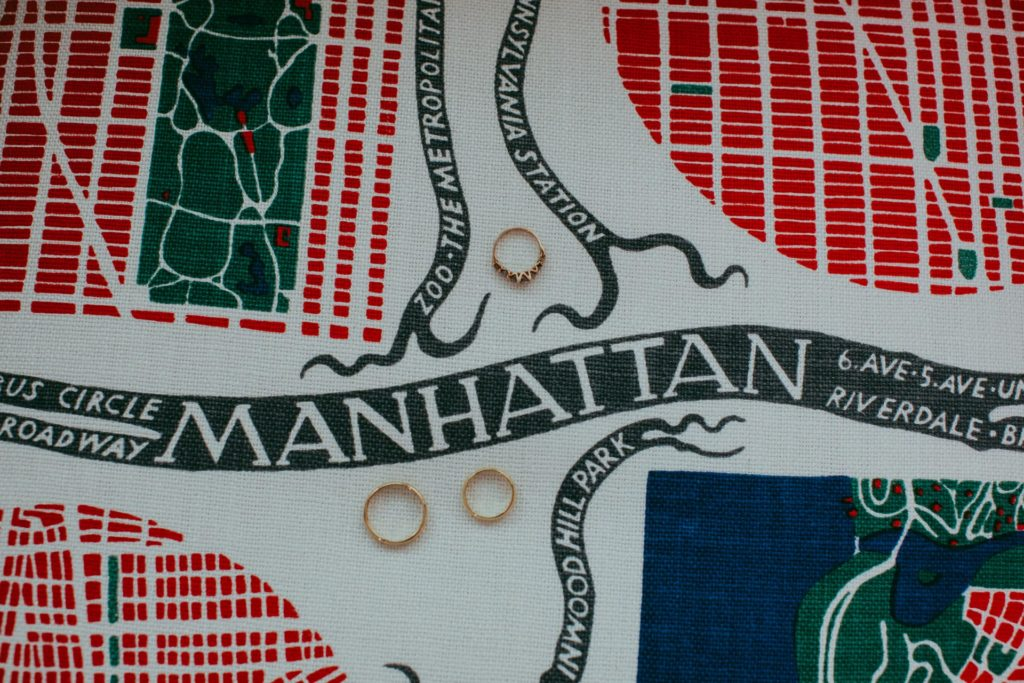 Wedding details with rings and NYC upholstery at Maritime Hotel in New York, NY