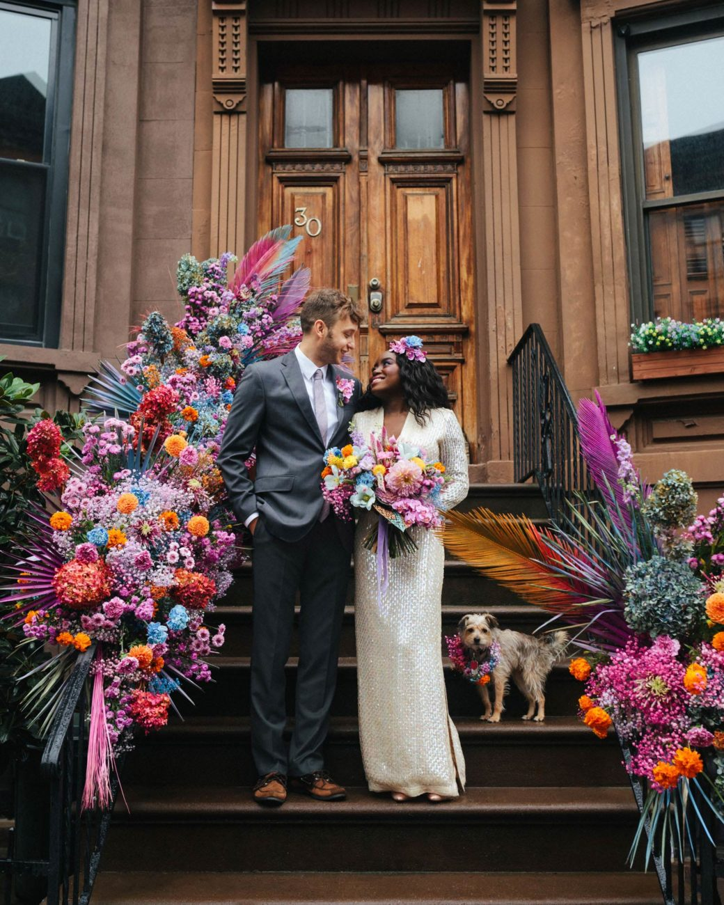NYC stoop wedding elopement with vintage dress and rainbow floral installation