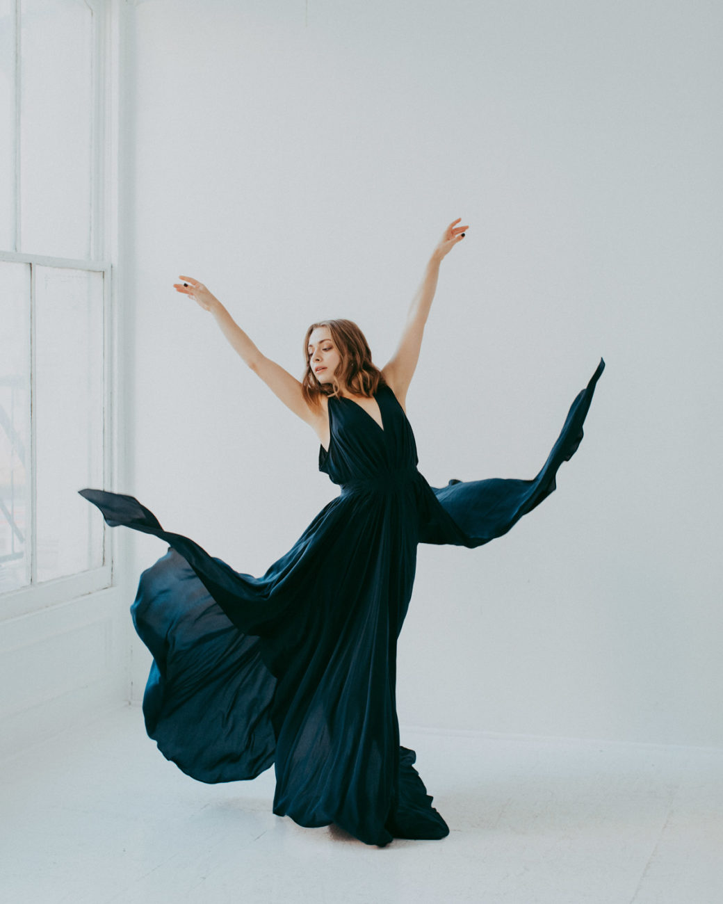Steph dances in a studio in NYC wearing Jasmine Chong blue chiffon gown