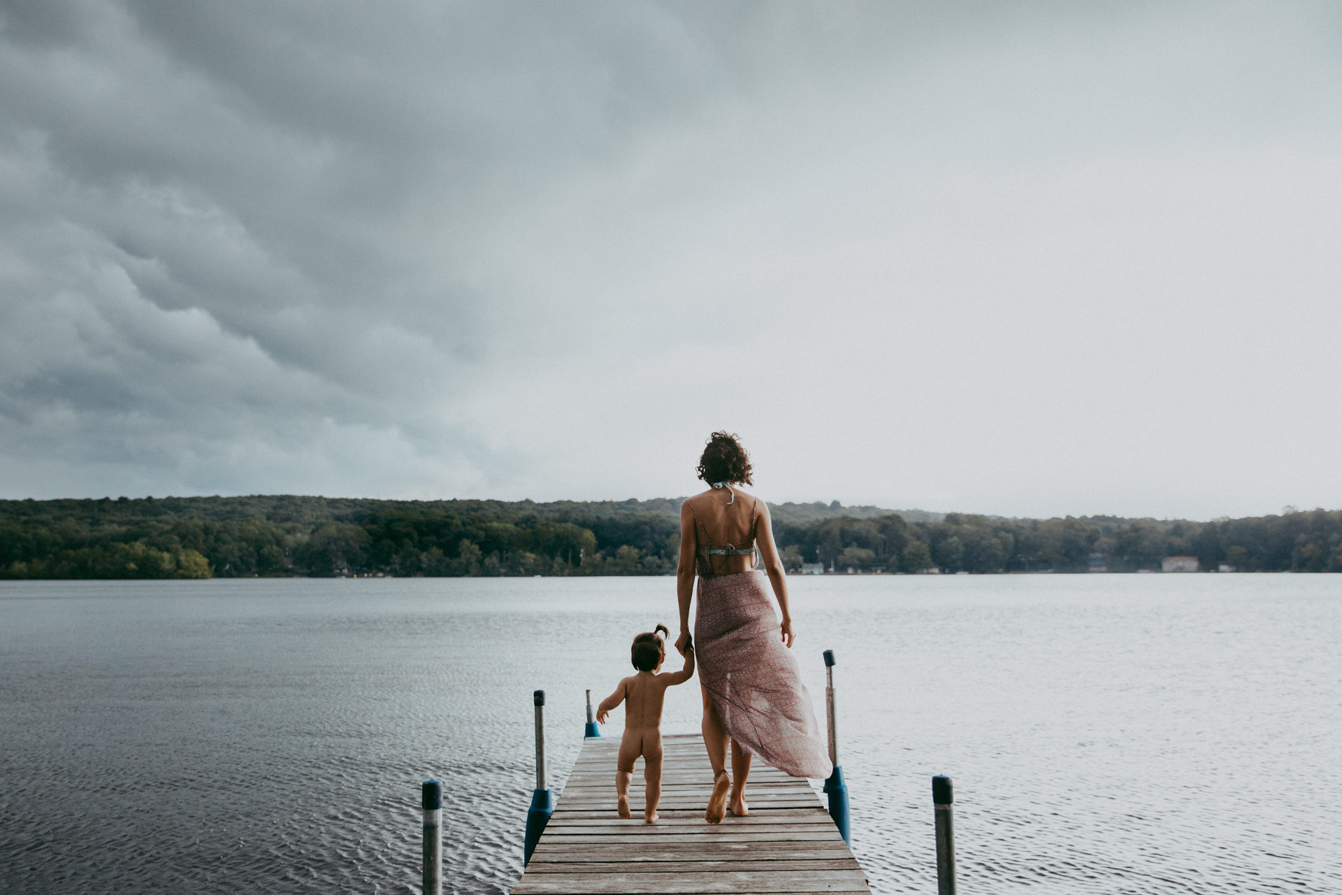 Mother and daughter on the lake with dramatic sky in Old Lyme CT